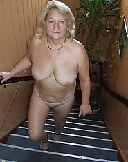Naked mature mama strolling through the hallway