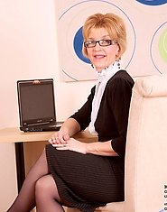 Gorgeous Poppy strips off her office clothes and flaunts her mature body on top of the table