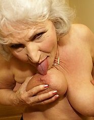 This granny loves to get nasty on her own