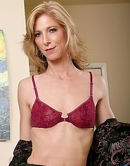 Beautiful mature Dee Dee removes her business attire to reveal her maroon bra