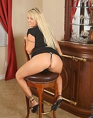 Lustful blonde Anilos exposes her beautiful pink milf clitoris