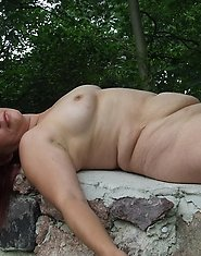 This mature nympho loves to get naked outdoors