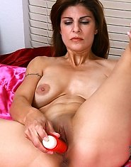 Horny Anilos milf shows off her big bosoms and fucks her needy pussy with a red vibrator