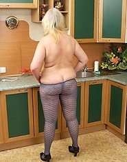 Cute mature BBW posing in pantyhose