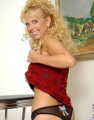 Sensual anilos cougar merilyn strips off her red dress revealing a sexy sheer bra and panty set