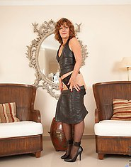 Naughty Anilos Cascade teases us in her black leather mini dress