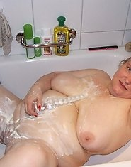 Big mama playing with whipped cream in the tub