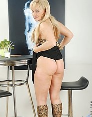 Anilos Renata lifts up her sexy black skirt revealing her form fitting sheer thongs