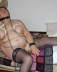 This chubby mama loves bondage and chains