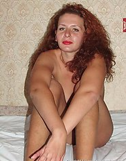 Anna is a nice-looking housewife from some small Ukrainian town. She is posing for you, showing her unshaven hairy pussy, smoking etc...