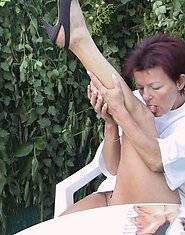 Mature slut playing with herself in the garden