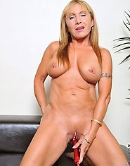 Glamorous Anilos Luna has incredible huge tits and a thick irresistible ass and she stuffs a dildo deep in her juice box