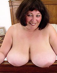 This big titted mama loves showing her body
