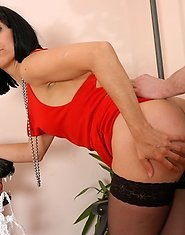 Mature brunette in scarlet gown quenching her itch with a young service man