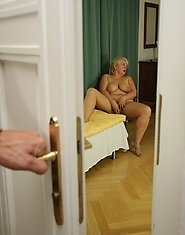 His mother in law is playing with her pussy and she seduces him with relative ease