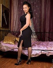 Erotic Anilos Donna has huge breasts that are ready to burst out of her dress