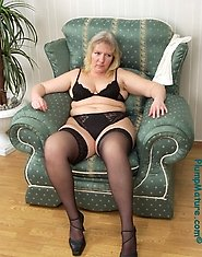 Beautiful fatty posing in black stockings