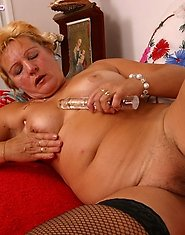 Chubby blonde mum lets a glass dildo into her slit