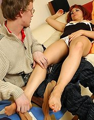 Leggy milf with fiery mane seducing a shy guy into steamy romp on the sofa